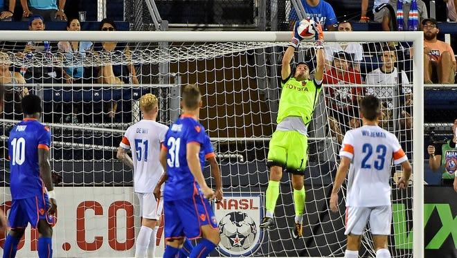 FC Cincinnati goalkeeper Mitch Hildebrandt (1) makes a save against the Miami FC during the second half at Riccardo Silva Stadium.