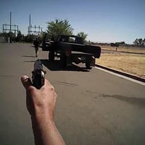 In this image made from a June 25, 2016, police body-camera video released by Fresno Police Department, a police officer points a gun at Dylan Noble after he shot him in Fresno. Whether Noble was dead in this video was unknown. Fresno police on Wednesday, July 13, released body-camera video of officers fatally shooting Noble, 19-year-old man who ignored repeated commands to stand still and show his hands.