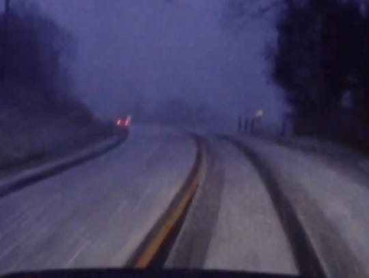 A dashboard camera captures lightning and thunder during