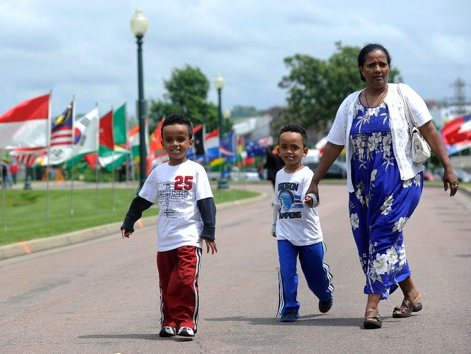 Nathan Gebre and his brother, Nahom, attend the 18th annual Festival of Cultures with their aunt, Rigbe Gebrekel, at Falls Park in Sioux Falls, S.D., Saturday, June 14, 2014.