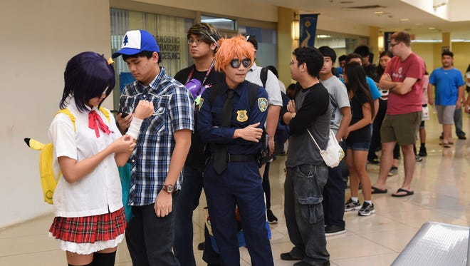 Event goers wait in line for the start of Epixcon 2016 at Agana Shopping Center in Hagatna on July 23.