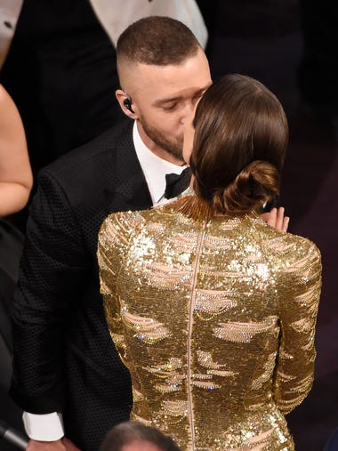 Justin Timberlake, left, and Jessica Biel kiss in the