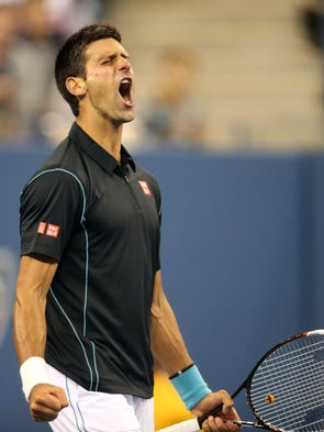 Novak Djokovic of Serbia celebrates his 6-3, 6-2, 3-6, 6-0  victory against Mikhail Youzhny of Russia.