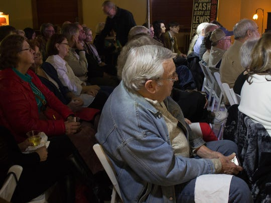 Audience members listen to blues and rock 'n' roll music during a concert at the Carnegie Center on Friday night.