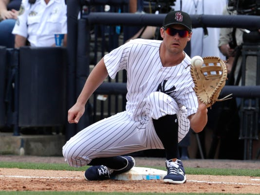 FILE - In this Feb. 23, 2018, file photo, New York Yankees first baseman Greg Bird fields the ball during a baseball spring exhibition game against the Detroit Tigers, in Tampa, Fla. Yankees manager Aaron Boone says it's too early to know if first baseman Greg Bird will be sidelined opening day Thursday at Toronto because of inflammation in his right foot. Boone said the team should learn Bird's status after he's evaluated Monday, March 26, 2018, by a specialist in New York. (AP Photo/Lynne Sladky, File)