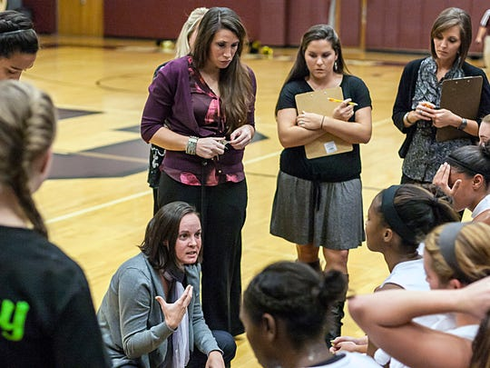 Station Camp head coach Kendra Jackson (center) returns to the bench this season after having a bone marrow transplant in May to help her battle with lymphoma cancer. Her sister, Christina MacLean, donated the stem cells.