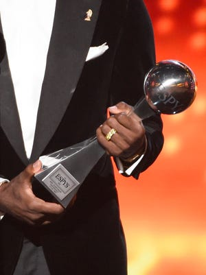 NBA star LeBron James of the Cleveland Cavaliers accepts the award for best championship performance at the ESPY Awards on Wednesday, July 15, 2015, in Los Angeles.
