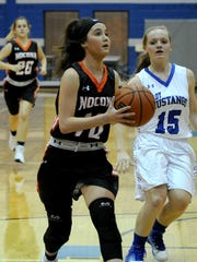 Nocona's Emma Meekins drives to the basket in the game