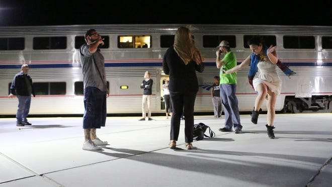 Passengers enjoy a brief stop at Palm Springs North Amtrak train station to stretch their feet and take cigarette breaks before reboarding the combined Sunset Limited and Texas Eagle trains heading westbound to Union Station in Los Angeles at 3:25 a.m. on Wednesday, June 3, 2015.