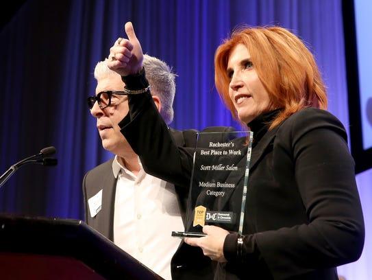 Scott Miller and his wife Helen Miller accept the award