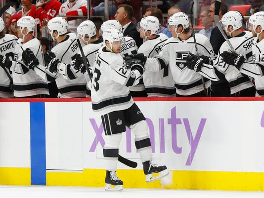 Los Angeles Kings right wing Dustin Brown (23) celebrates his goal against the Detroit Red Wings in the second period of an NHL hockey game Tuesday, Nov. 28, 2017, in Detroit. (AP Photo/Paul Sancya)