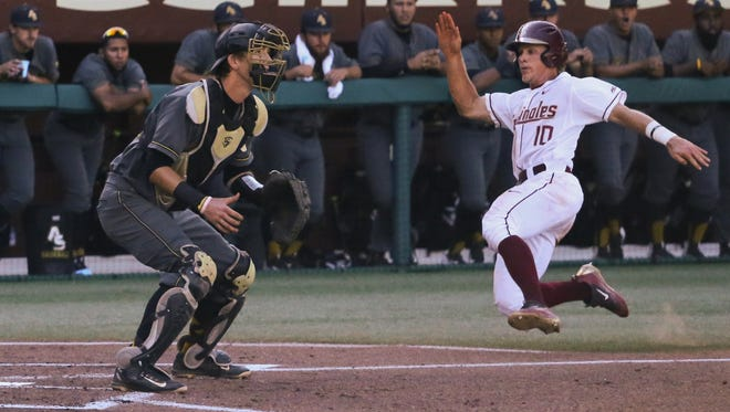 Taylor Walls slides in safely for one of FSU's 18 runs in their win over Alabama State.