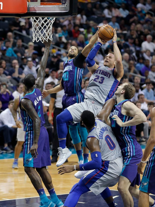 Charlotte Hornets' Michael Carter-Williams (10) blocks Detroit Pistons' Blake Griffin (23) shot during the first half of an NBA basketball game in Charlotte, N.C., Sunday, Feb. 25, 2018. (AP Photo/Bob Leverone)