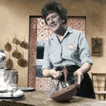 """Julia Child is credited with introducing French cooking techniques to mainstream America on her Public Television show """"The French Chef."""" The program first aired in 1963. Here, she prepares a chocolate mousse."""