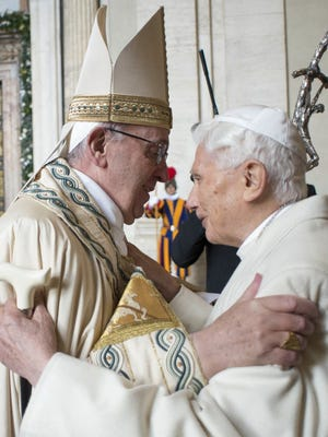 Pope Francis and Pope Emeritus Benedict XVI embrace Dec. 8, 2015, at a ceremony to mark the start of the Holy Year at the Vatican.