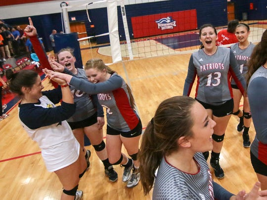 Powdersville High School volleyball players celebrate a 3-2 win over Palmetto in Greenville.