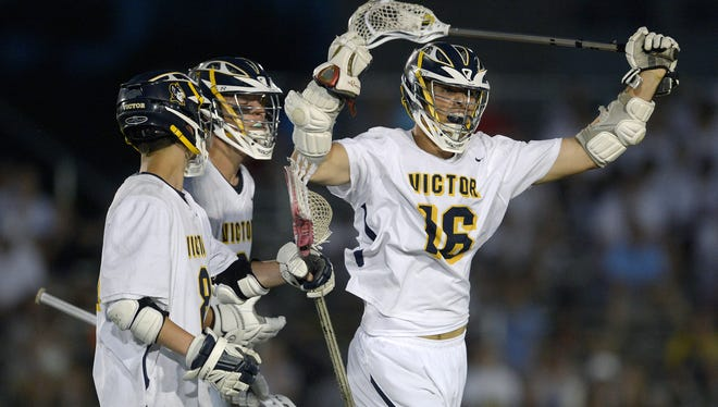Victor's Alexander Mabbett, right, celebrates his game-tying goal at the end of regulation during the Section V Class B championship game at St. John Fisher College, Wednesday, May 30, 2018. No. 1 seed Victor claimed the Class B title with a 10-9 double overtime win over No. 2 seed Webster Thomas.
