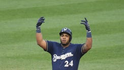 Jesus Aguilar drove in all three runs for the Brewers.