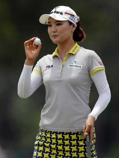 So Yeon Ryu, of South Korea, reacts after making a putt on the third hole during the final round of the U.S. Women's Open golf tournament.