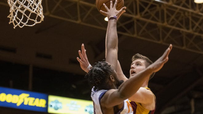 Canton's Dean Wade, back, goes up for a two-point shot over Northern Arizona's Aaron Epps in February.