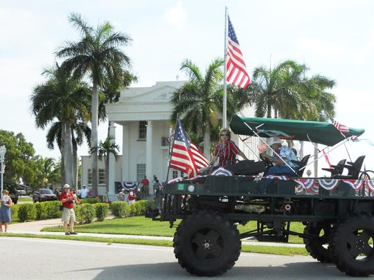 A highlight of the Everglades City Independence Day celebration is the patriotic parade, featuring swamp buggies and golf carts.