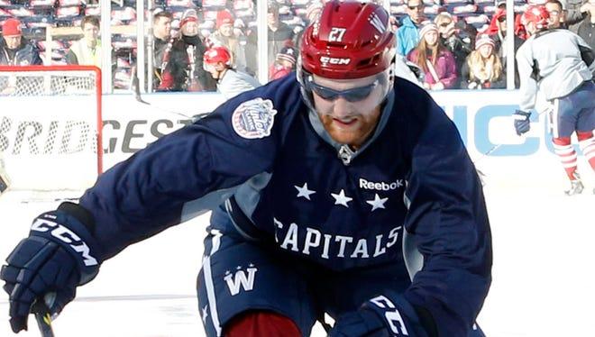 Washington Capitals defenseman Karl Alzner wears sunglasses during practice on Wednesday.
