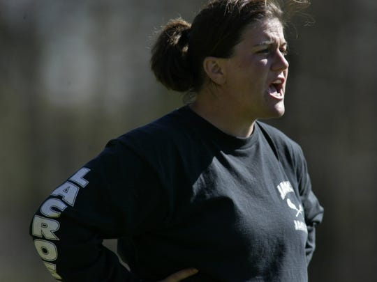 (Psports)-4/24/02-Photo by Peter Ackerman-Southern coach Lori Johnson calls instructions from the sideline.