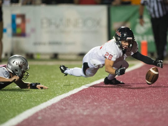 Maryville's Noah Humphreys recovers a fumble by Alcoa's Walker Russell on Friday, September 8, 2017.