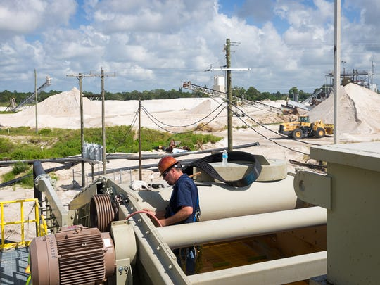 Sand is processed at the Ortona mine in Glades County southwest of Lake Okeechobee in July.  The mine was the source of sand for Broward County's recent $37 million beach renourishment.