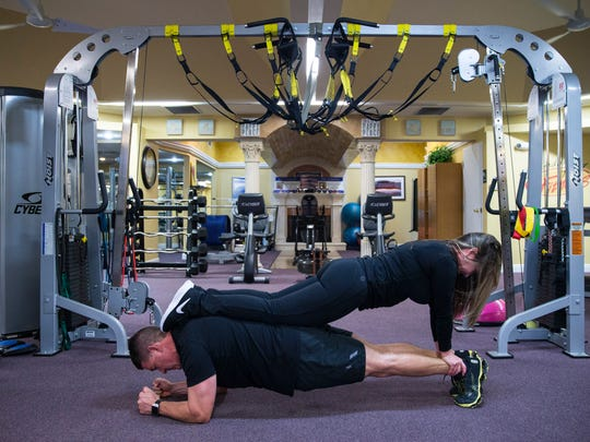 Exercise 1: The sweet stack Begin this exercise with one partner on the ground in a plank position. The second partner lies on top in the opposite direction, grasping their partner's legs, in a push-up-like position. Hold for 30 seconds and release.