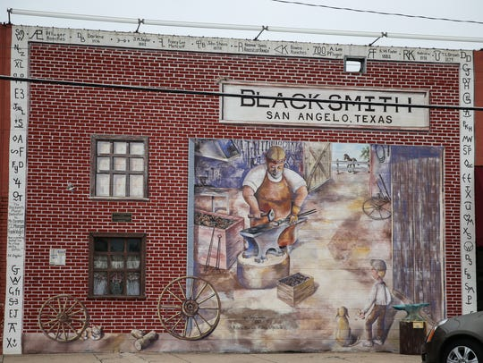 A mural depicting a blacksmith shop is located on Oakes