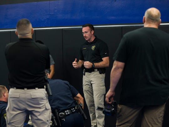 Officer Braden Tackett (center) critiques cadets after