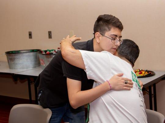 "Brannden Fernandez, 14, (left) greets James ""Mr. Miyagi"" Miyagishima, 64, (right) at the transplant group meeting Thursday evening at Mountain View Regional Medical Center on May 10."