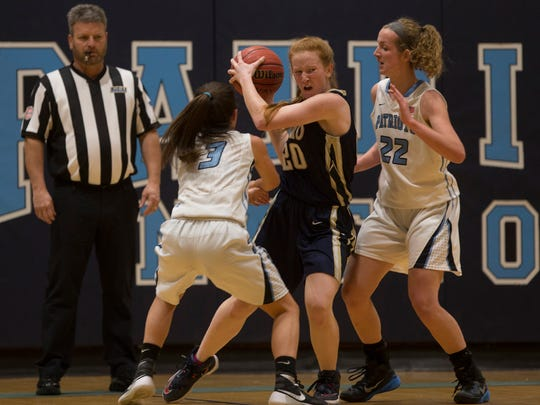 Freehold Boro's Sydney Przygoda finds herself boxed in by Freehold Township's Theresa Sanzone  and Kaity Potter. Freehold Township vs Freehold Boro Girls Basketball in Freehold Township, NJ on January 19, 2017.
