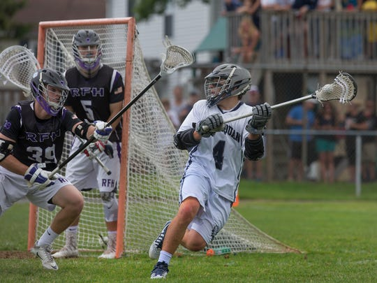 Rumson's Stephen Edler and Conor Deverin works to deny Manasquan's Jarrett Brich an easy shot at goal. Rumson-Fair Haven Boys Lacrosse edges out Manasquan for South Group 2 Sectional Title in Manasquan NJ on May 27, 2017.
