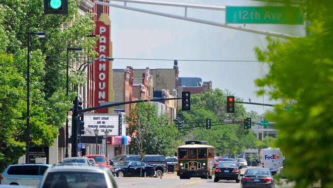 Traffic moves along St. Germain Street in downtown St. Cloud on Friday.