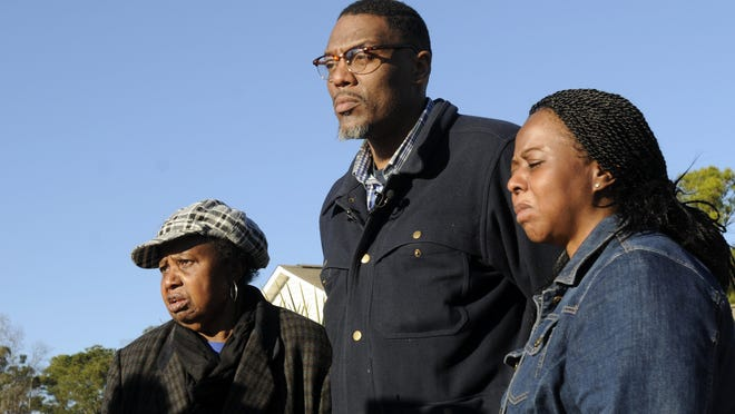 The family of missing Jayden Morrison, from left, grandmother Carolyn Sumpter, father Andre Morrison and mother Tabatha Morrison watch the search for the boy in Little River on Christmas Day.