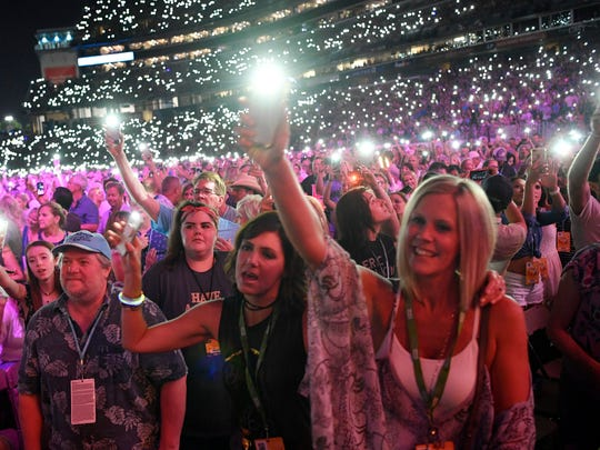 The crowd lights up Nissan Stadium at the 2018 CMA Music Festival in Nashville.