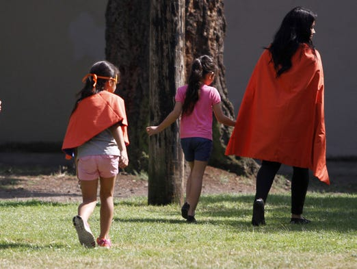 Maria Rivera and her children at Marion Square Park on Friday, Aug. 15, 2014, in Salem, Ore.