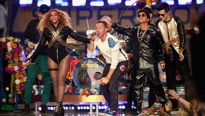 From left: Jonny Buckland of Coldplay, Beyonce, Chris Martin of Coldplay, Bruno Mars and Mark Ronson perform onstage during the Pepsi Super Bowl 50 Halftime Show at Levi's Stadium on Feb. 7 in Santa Clara, California.