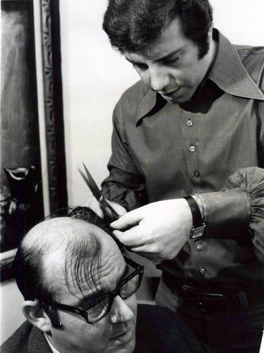 Man getting a haircut in 1970.