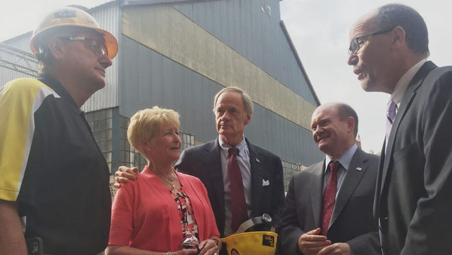 Robert Suppe (left), vice president of R.C. Fabricators in Wilmington, greets U.S. Labor Secretary Thomas Perez (far right), while company president Rebecca Suppe, U.S. Sen. Tom Carper and U.S. Sen. Chris Coons look on Monday, Oct. 3, 2016.