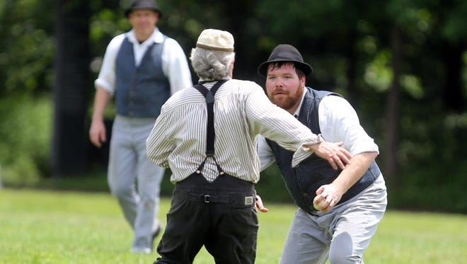 """Stewart's Creek Scouts player William """"Iron Belly"""" Donaldson, in the hat and vest, prepares to tag out a base runner from the Franklin Farriers during their vintage base ball game Sunday in Nashville."""