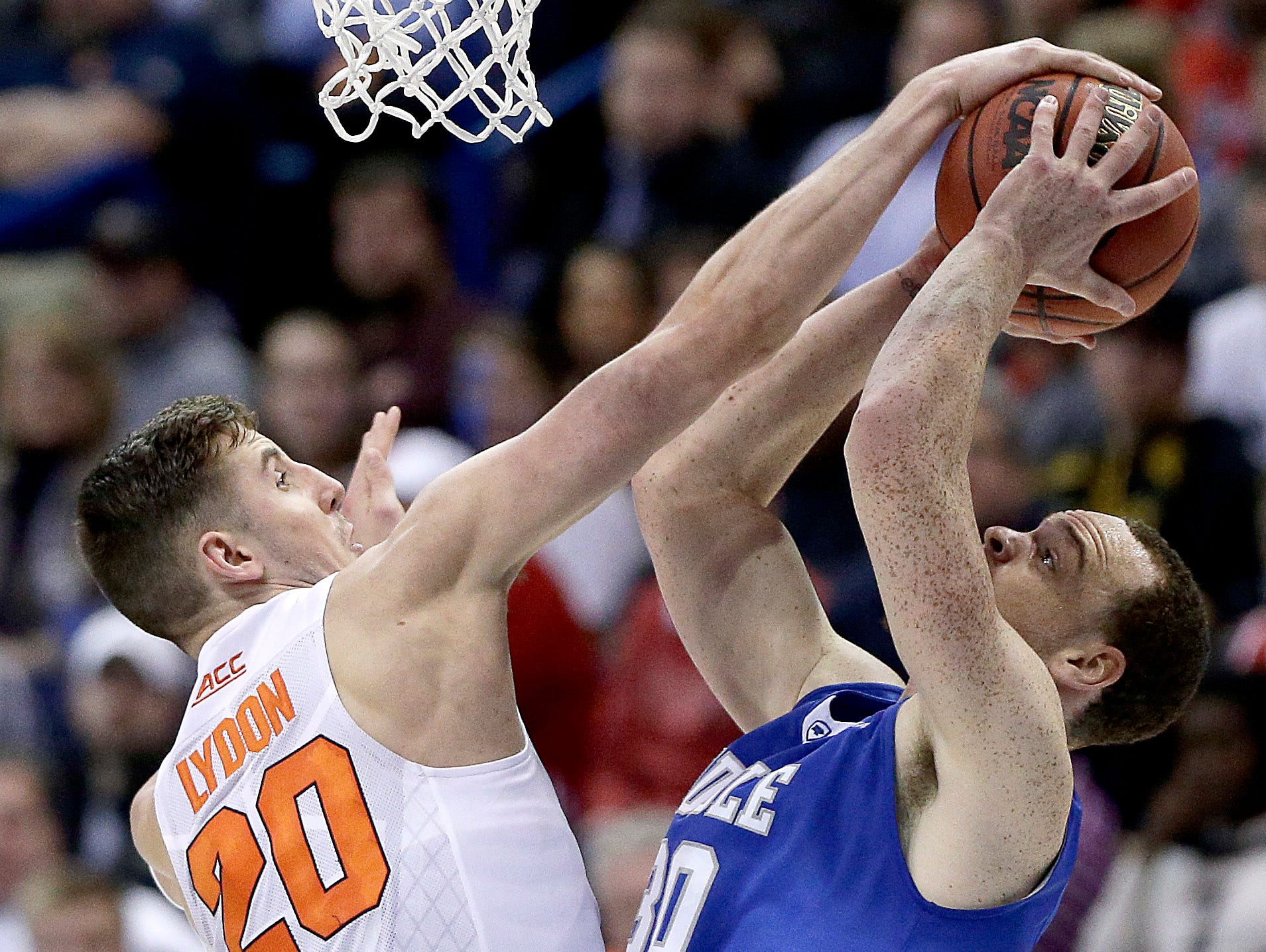 Syracuse's Tyler Lydon, left, blocks a shot by Middle Tennessee's Reggie Upshaw Jr. during the NCAA Tournament on March 20 in St. Louis.
