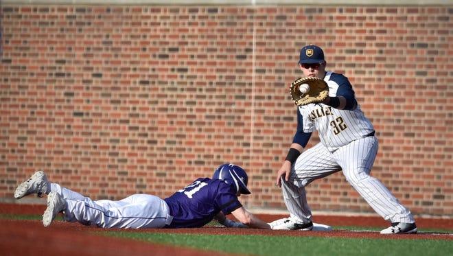 Moeller's Mo Schaffer fields a pick-off attempt  on Elder's Bean Burke Wednesday, April 11th at the University of Cincinnati