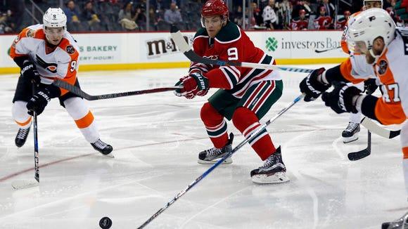 New Jersey Devils left wing Taylor Hall (9) battles