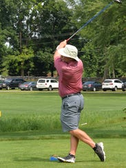 Jeff Frazier hits his drive at the first hole during