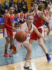 Northville's Tara Beason scrambles for the loose ball in Tuesday's Class A regional semifinal vs. Walled Lake Western.