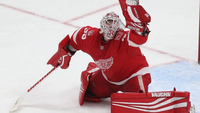 Red Wings goalie Jimmy Howard makes a save against the Panthers during the third period Friday.