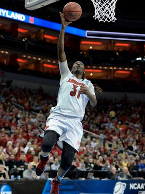 Louisville Cardinals forward Asia Taylor (31) shoots against the LSU Tigers.
